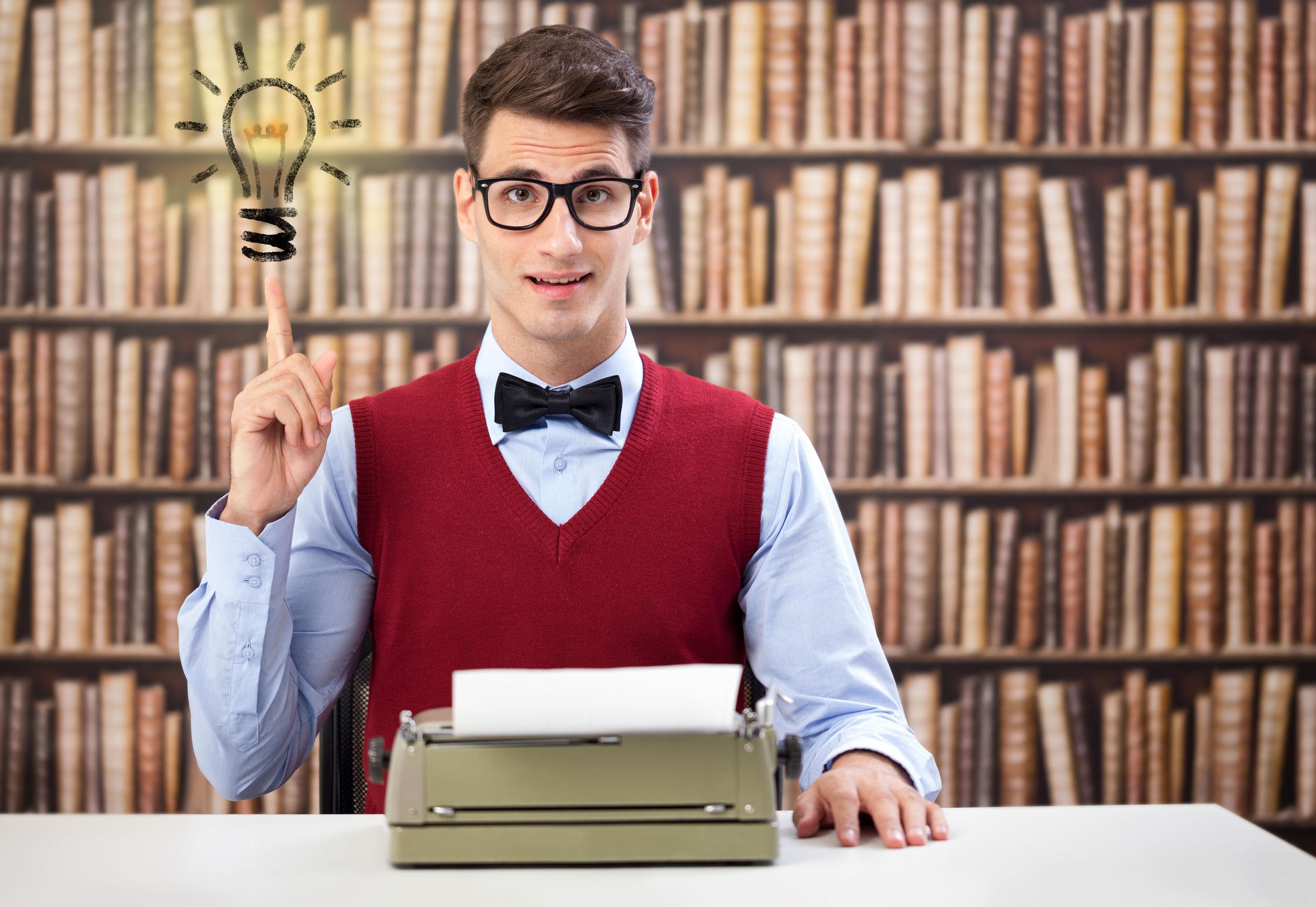 Writer guy at typewriter with idea.jpg